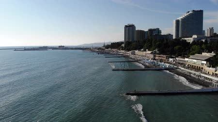 Aerial view of the city, standing on the coast, from the sea. Sea view of the city beach and the city itself. The city of Sochi from the sea. 4K Wideo