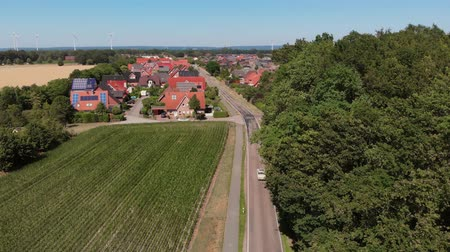 Air view as a retro car pulls up to a small German city. Greven, Germany. Aerial view 4K Vídeos