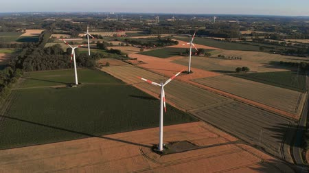 Aerial wiev of windmills farm. Power Energy Production. The camera flies back from the windmills