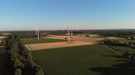 Aerial wiev of windmills farm. Power Energy Production. The camera flies up to the windmills
