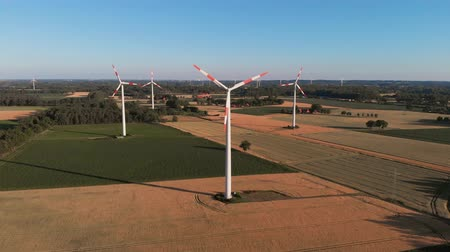 Aerial wiev of windmills farm. Power Energy Production. Static frame. The camera is not moving Vídeos