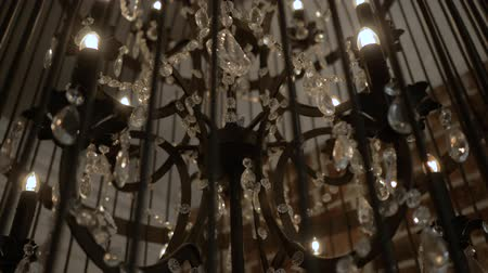 viktoriánus : Chandelier in loft style on a black background. Chandelier on a black background, the object of luxury fashion. A chandelier in the shape of a bird cage