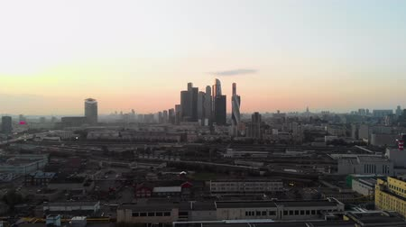A sunset aerial shot of skyscrapers of Moscow International Business Center, Moscow-city. Moscow aerial high altitude drone flight. 4K