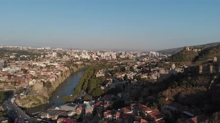 concert hall : Tbilisi, Georgia. Top View Of Famous Landmarks In Summer Evening. Georgian Capital Skyline Cityscape. Bridge Of Peace, Concert Hall, Rike Park. Cableway Around Kura River