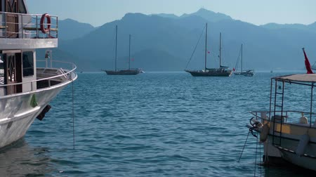basque : Look from the dock at the yachts standing in the sea. The camera looks out to sea past parked yachts. Yachts in the Parking lot Stock Footage