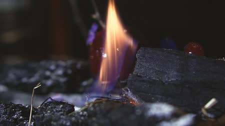fireplace : Kindling the fire on the coals Stock Footage
