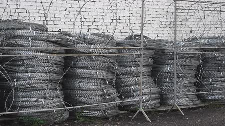 furl : A roll of barbed wire over white background Stock Footage
