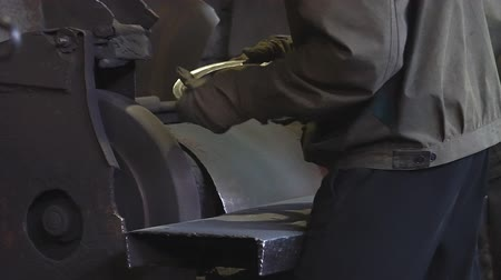 angle grinder : Working man with angle grinder, process of cutting carbonated steel metal with quantity of sparks in workshop Stock Footage