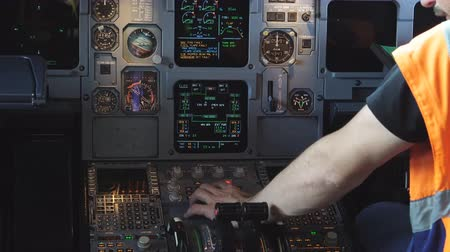 first officer : Engineer checks the electronics in a passenger plane 4K Stock Footage