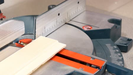 miter saw : Cutting wooden plank with miter saw