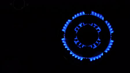 inflammable : Natural gas inflammation from kitchen stove, dark shot, view from top Stock Footage