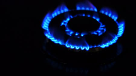 inflammable : Natural gas inflammation from kitchen stove, dark shot