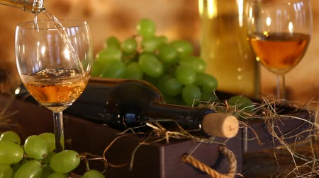 meal : Beautiful composition of white wine. Wine poured from bottle into the glass. Stock Footage