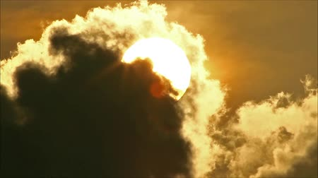 evening sun : Tropical Sun Behind Cloud Stock Footage