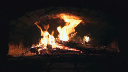 video footage with burning wood in Russian stove  warming retro technology