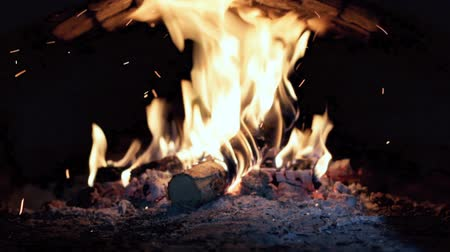 video footage stone fireplace with burning wood firewood Stock Footage