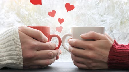 video footage hearts soaring between a pair of people meeting in a cafe against the background of a frozen window. hot feelings Stock Footage
