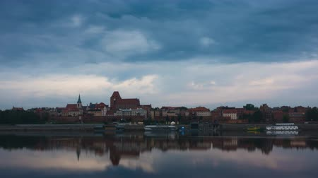 wisla : timelapse of sunrise above Torun town at the Wistula river bank Stock Footage