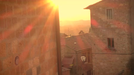 toscana : sunset over the italian town