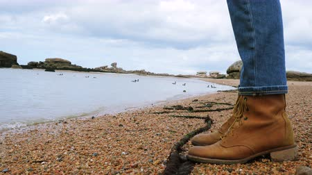 brittany : hiking boots of beautiful woman on a sea shore Stock Footage