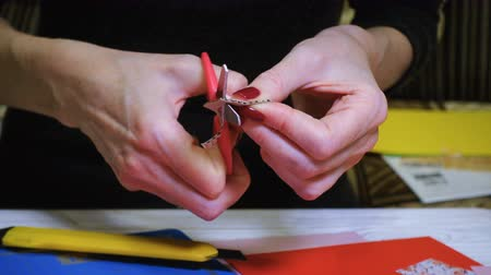 scrapbook : hands of girl making scrap Valentine greeting card