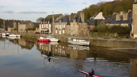 cobbles : DINAN, FRANCE - APRIL 06, 2018: view of the port of Dinan, River Rance, Brittany, France Stock Footage