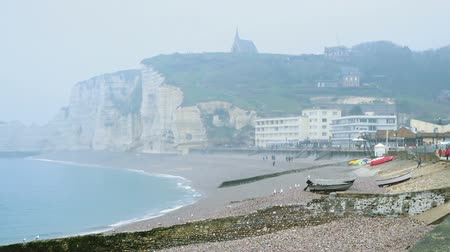 rocky cliffs and the sea at the Etretat, Normandy, France Stock Footage