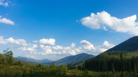 green mountain hills  and cloudy blue sky time lapse Stock Footage