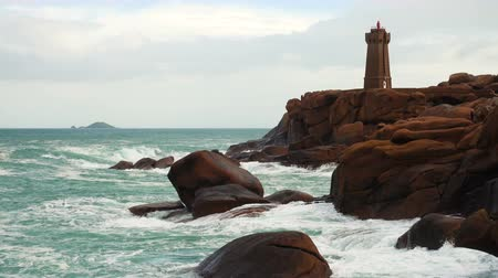 ploumanach : Phare de Men Ruz lighthouse at the Rose Granit Beach, Brittany, France Stock Footage