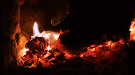 charcoal stove : burning logs at the fireplace close up Stock Footage