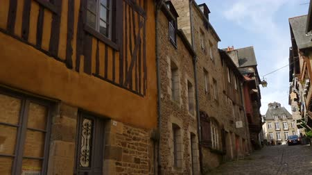 half timbered houses : DINAN, FRANCE - APRIL 06, 2018: view of empty beautiful street with old traditional houses at the center of Dinan, Brittany, France