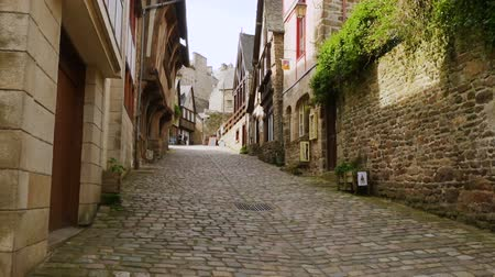 bretagne : DINAN, FRANCE - APRIL 06, 2018: view of empty beautiful street with old traditional houses at the center of Dinan, Brittany, France