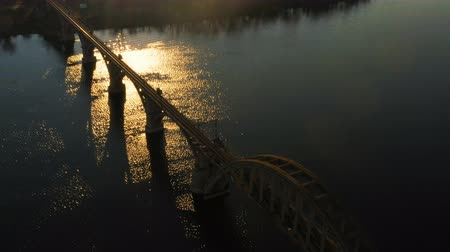 kötés : sunset aerial view of railroad bridge across the river and city skyline, Dnepr, Ukraine