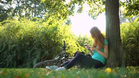 resting : girl with the bike resting at the park