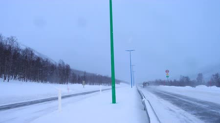 yolları : snow covered slippery road during the hard snowfall Stok Video