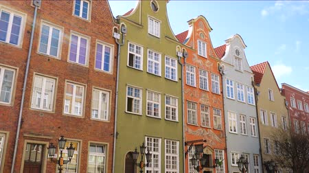 history : row of beautiful colorful buildings facades at the Gdansk city old town, Poland