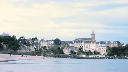 bretagne : Rocky coast at the beach of Dinard vith the views of Dinard old town and Saint Malo at the low tide time