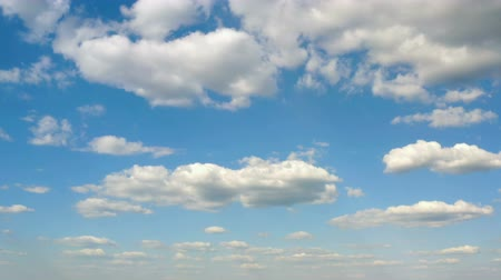 sztratoszféra : beautiful white clouds floating at the blue sky on a sunny day