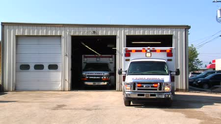 montana : ambulance with lights pulls out drives away Stock Footage
