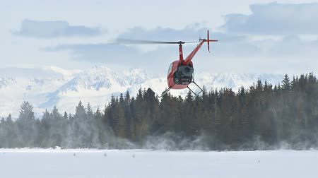 landing field : helicopter taking off from icy ground