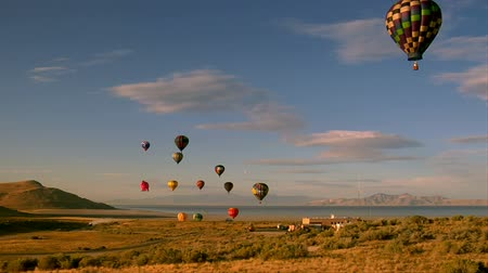 авиашоу : hot air balloons lifting into the sky shot from basket