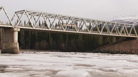 palmo : ore truck on stikine river bridge on cassiar highway