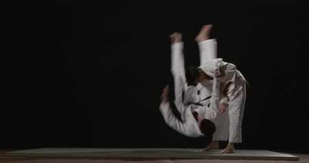 sztuki walki : Judo throw technique  slow motion on black background