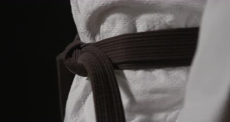 sztuki walki : Martial arts black belt on black background