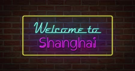 Neon text sign of Welcome to Shanghai in brick background