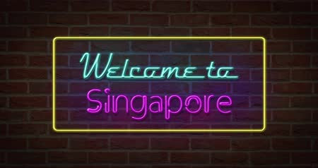 singapur : Neon text sign of Welcome to Singapore in brick background Stok Video