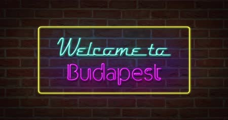 Neon text sign of Welcome to Budapest in brick background Stock Footage