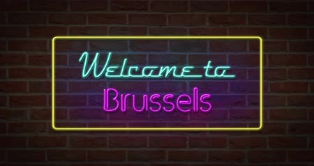 Neon text sign of Welcome to Brussels in brick background Stock Footage