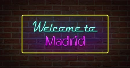 Neon text sign of Welcome to Madrid in brick background