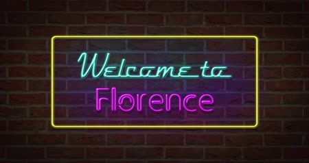 strojopis : Neon text sign of Welcome to Florence in brick background